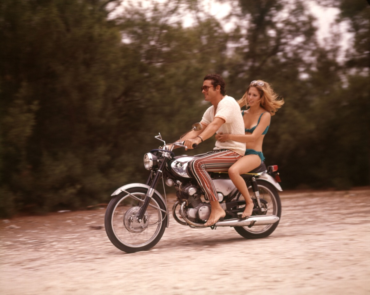 1970s couple rides motorcycle, cool grandparents