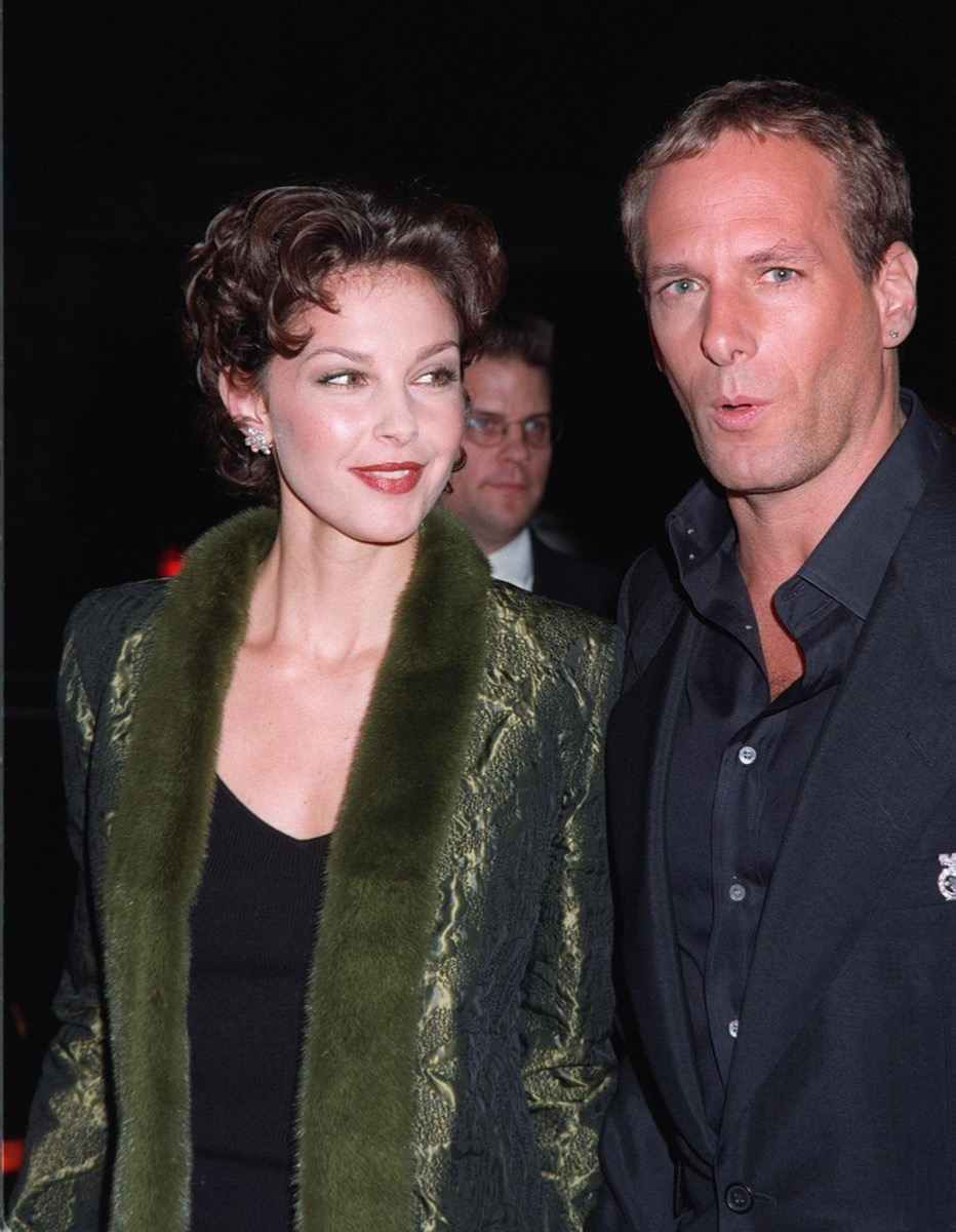 Celebrity Ashley Judd wears green coat and Michael Bolton in black shirt at 1997 CableACE Awards
