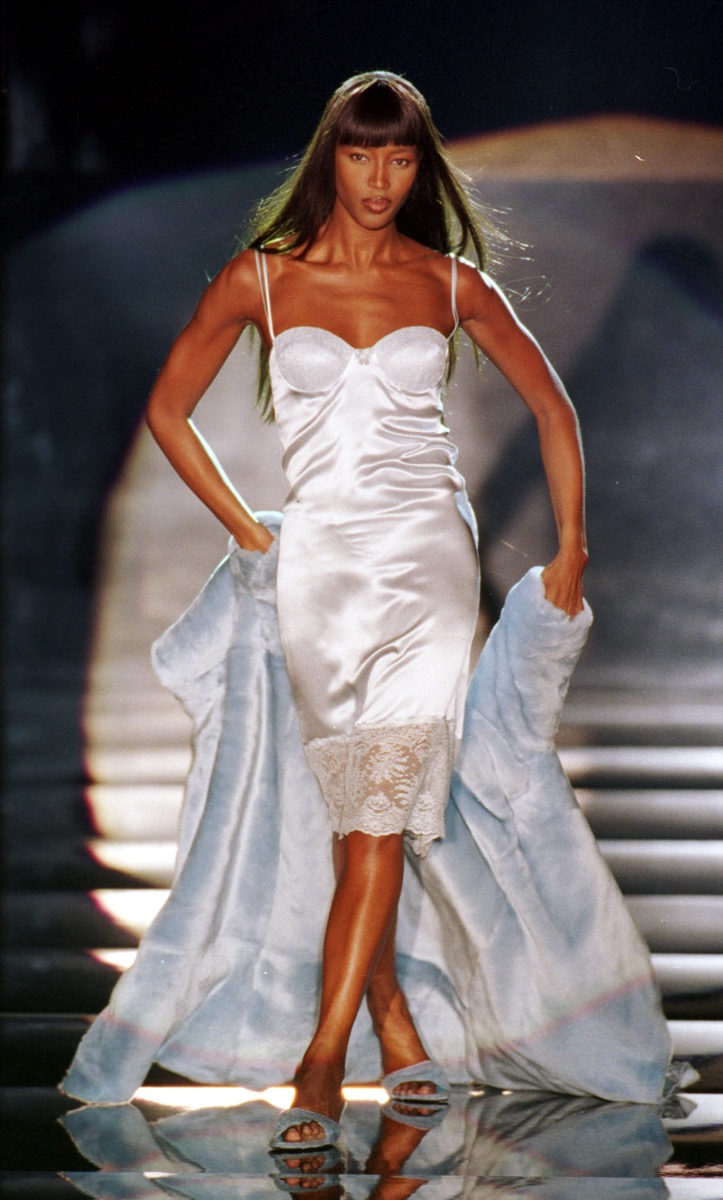 naomi campbell models in white slip dress, an example of a '90s fashion trend
