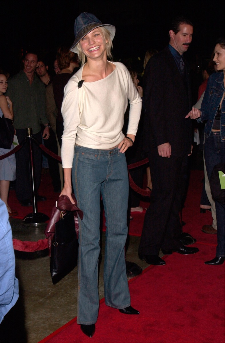 Celebrity Cameron Diaz in denim hat, cream top, and jeans at 2000 premiere of Requiem for a Dream