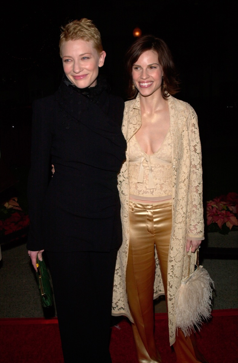 Celebrities Cate Blanchett and Hilary Swank pose at the 2000 premiere of The Gift