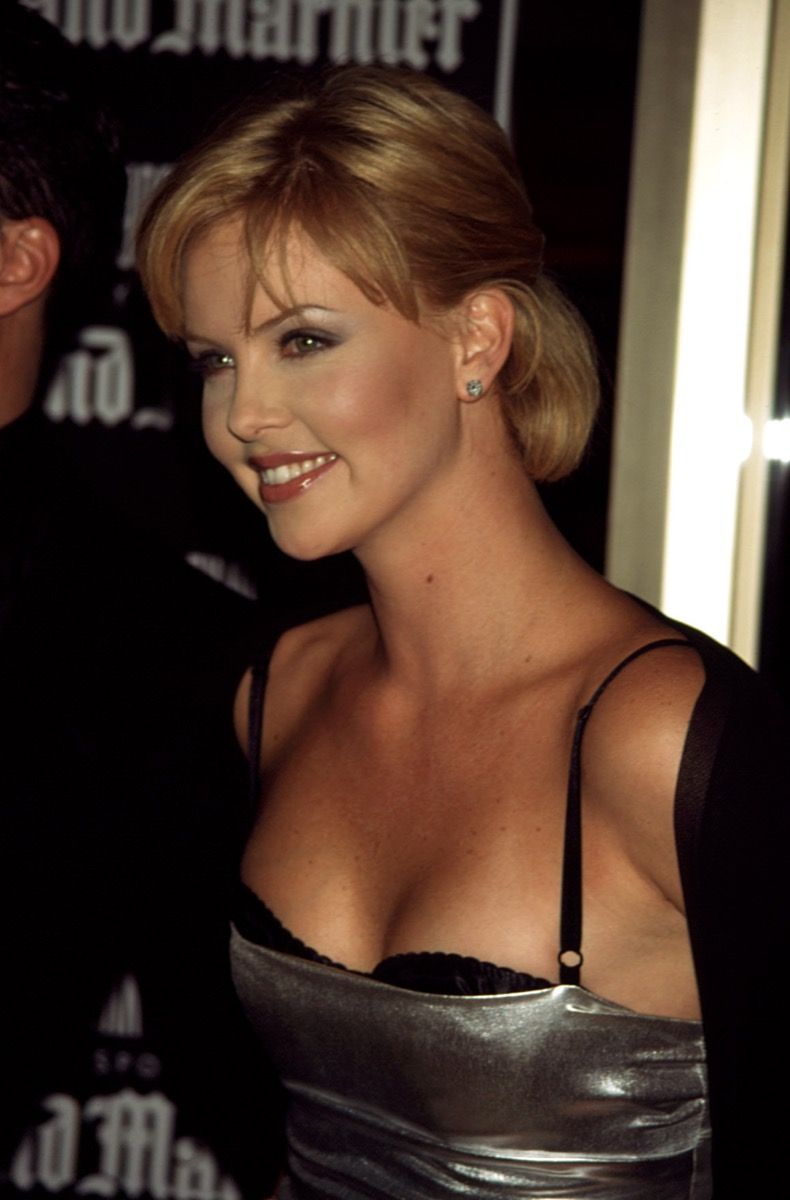 Celebrity Charlize Theron in silver and black lingerie dress at 1998 premiere of Celebrity