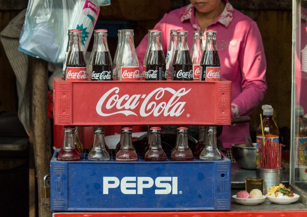 Woman selling Coke and Pepsi in Cambodia