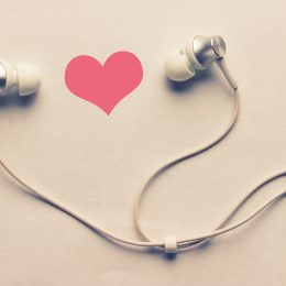 Earbuds against heart backdrop