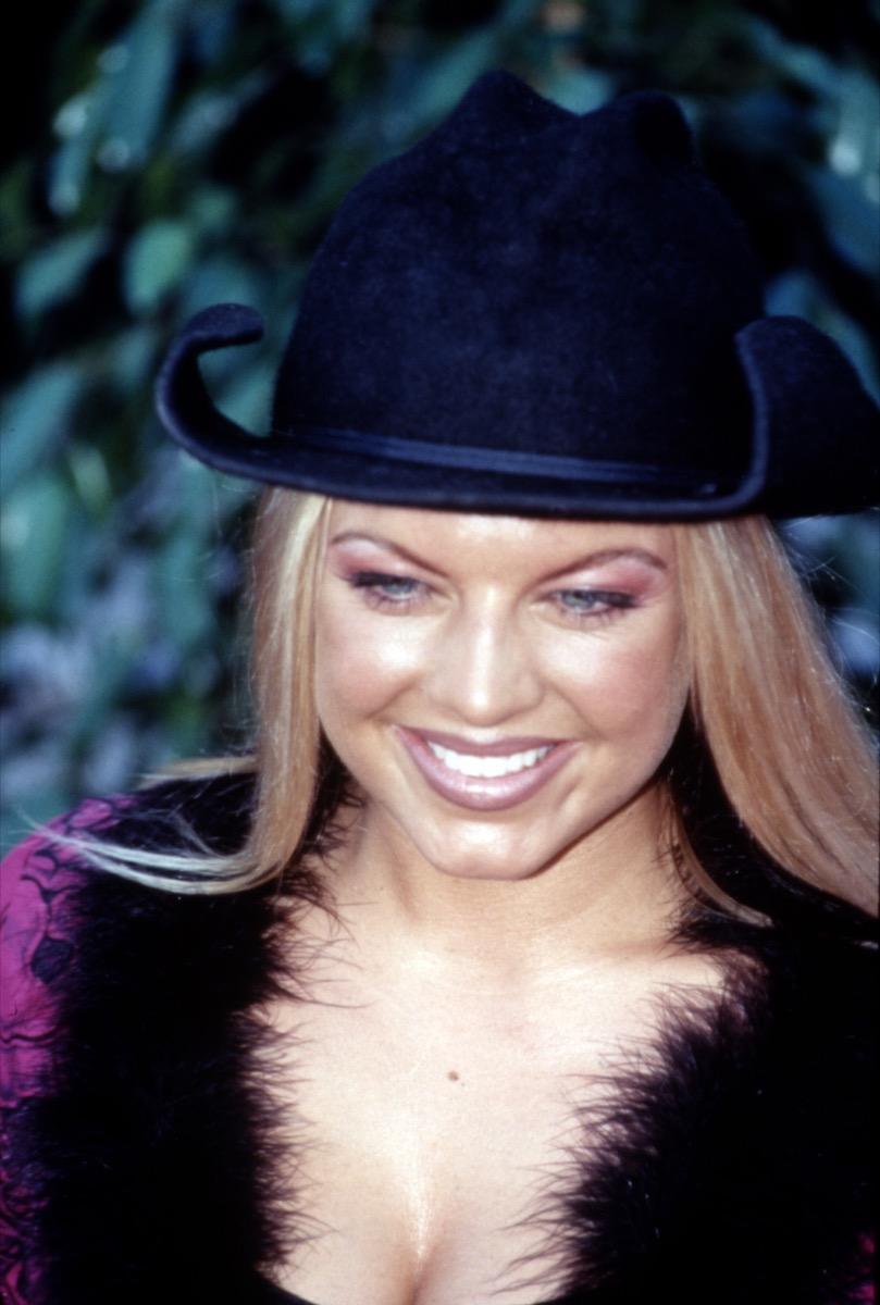 Celebrity and Wild Orchid member Stacy Ferguson AKA Fergie at 1999 Blockbuster Awards in cowboy hat and furry jacket