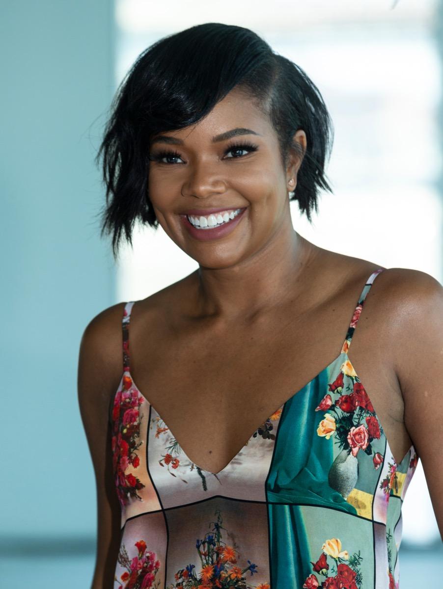 Gabrielle union wears asymmetrical haircut and floral top
