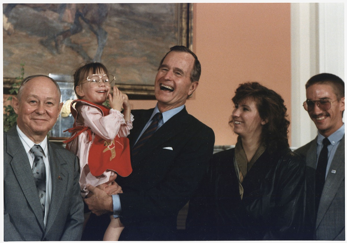 President George H. W. Bush meeting Baby Jessica McClure at the White House in 1989