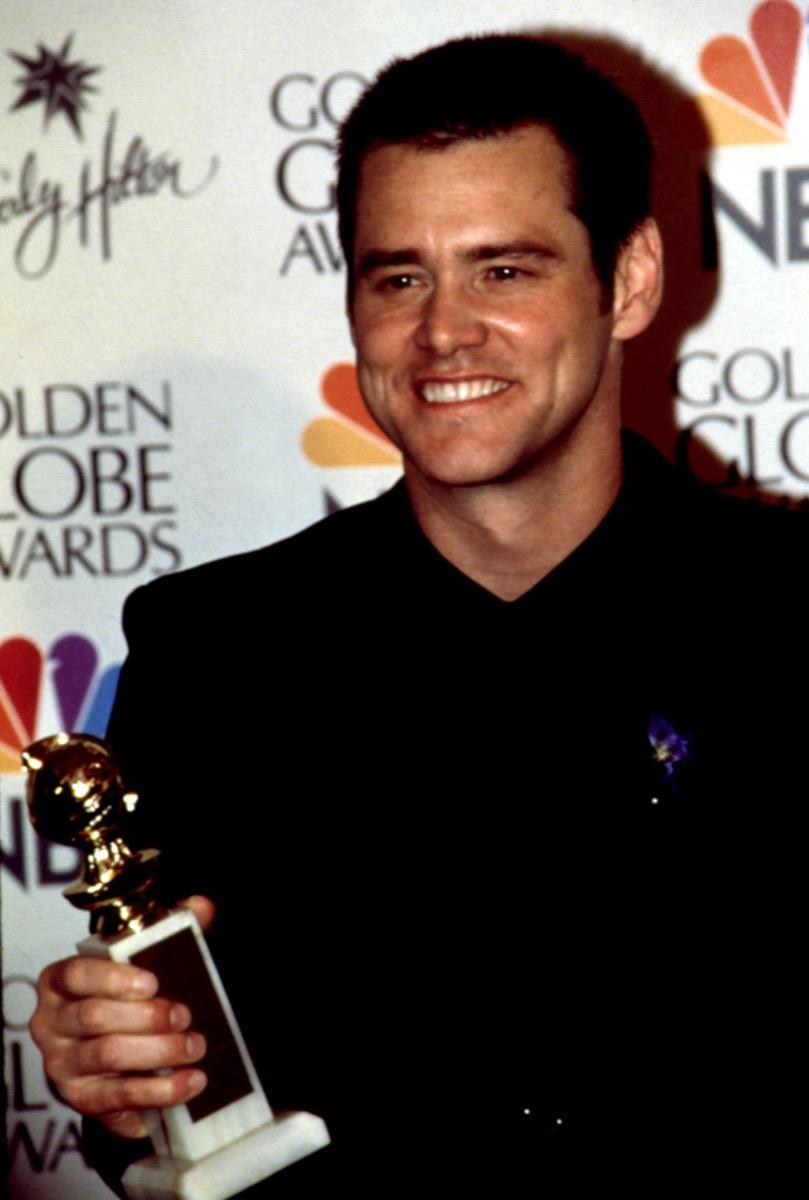 Celebrity Jim Carrey Wins 1999 Golden Globe in black suit