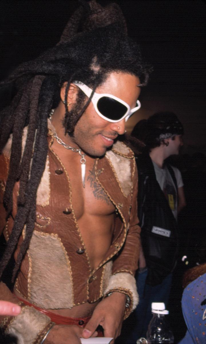 Celebrity Lenny Kravitz in cowboy jacket and white sunglasses at 1998 Betsey Johnson Fashion Show