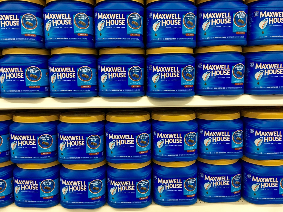 Store display with bulk blue containers of Maxwell House Coffee, state fact about tennesee