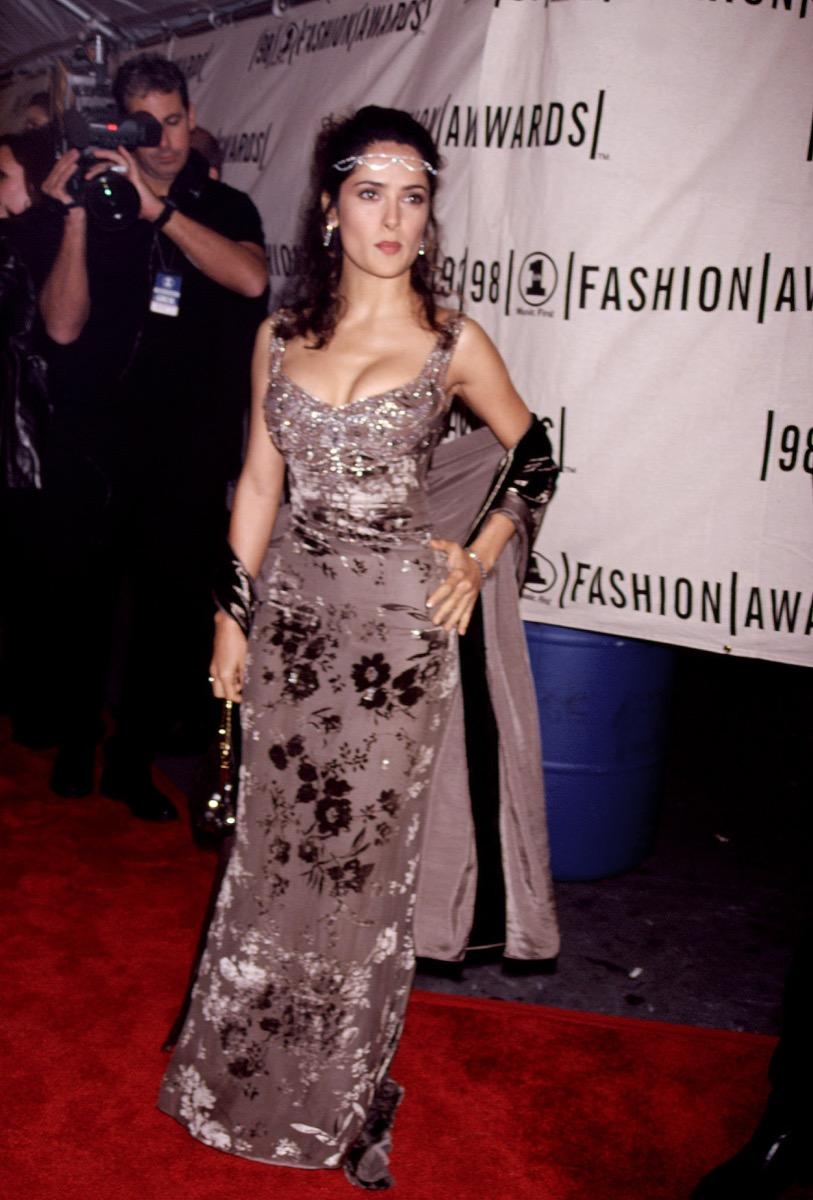 Salma Hayek in mauve velvet floral floor-length dress at 1998 VH1 Fashion Awards