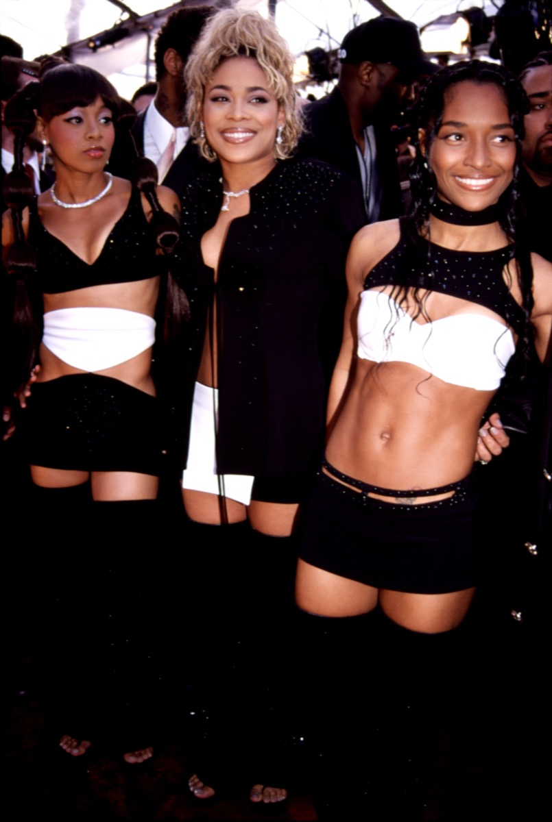 Celebrities and TLC members Rozonda Chili Thomas, Tionne T-Boz Watkins, and Lisa Left Eye Lopes in revealing black and white outfits at 2000 Grammys