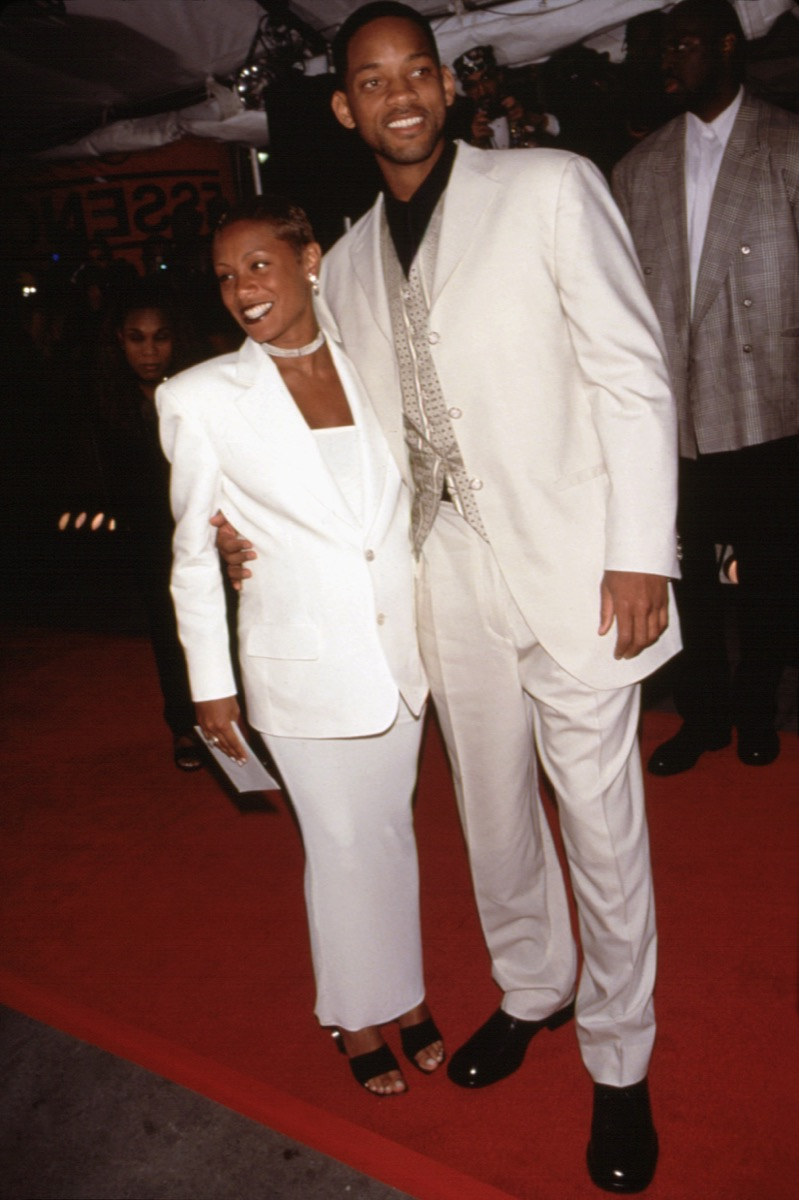 Celebrities Will Smith and Jada Pinkett Smith wear matching white suits to the Essence Awards in 1998