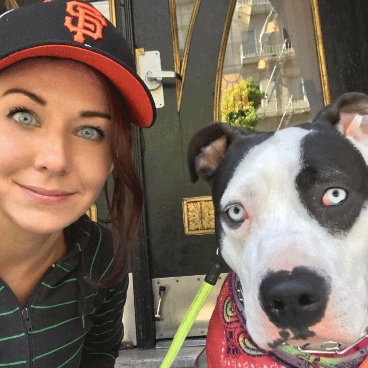 blue eyed woman has same exact eyes as dog, dog and owner twins
