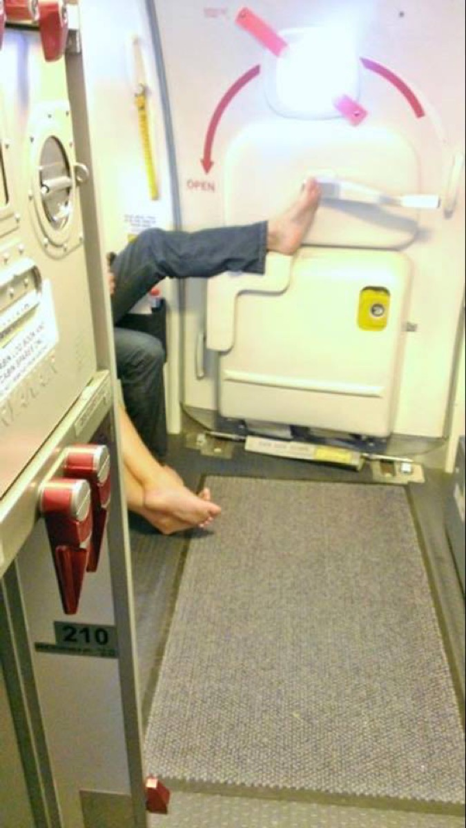 Airline passenger touching handle with foot photos of terrible airplane passengers