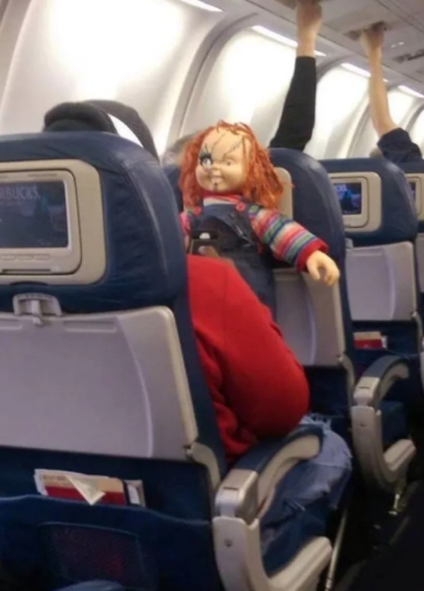 passenger with chucky doll photos of terrible airplane passengers