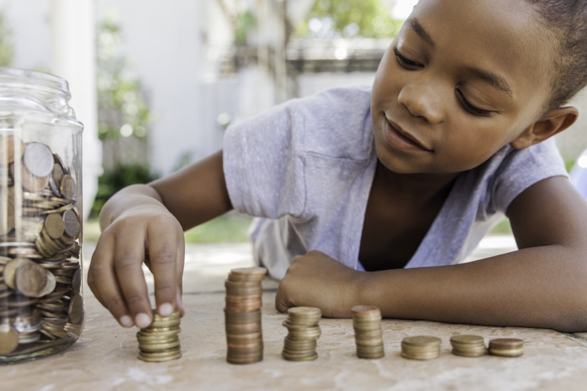 young girl counting the coins of her allowance