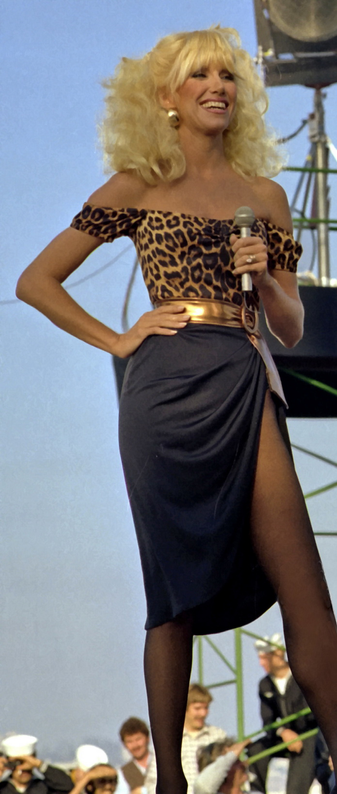 Suzanne Somers in animal print top entertains the crew aboard the aircraft carrier, 1980s fashion
