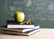 apple on a teacher's desk with books, best teacher gift ideas