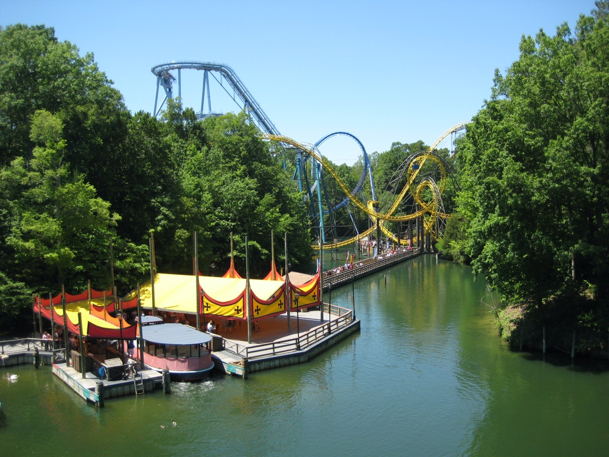 Roller Coaster and river boat ride at Busch Gardens in Williamsburg, Virginia on a sunny day.