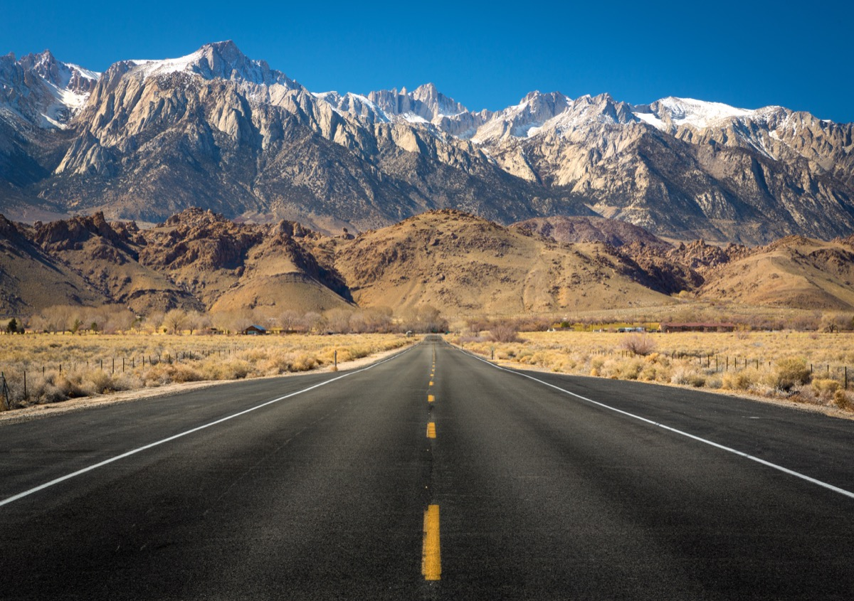 Mt Whitney sits at the end of a straight empty road, state fact about California