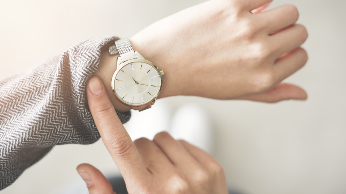 woman checking her watch on her wrist