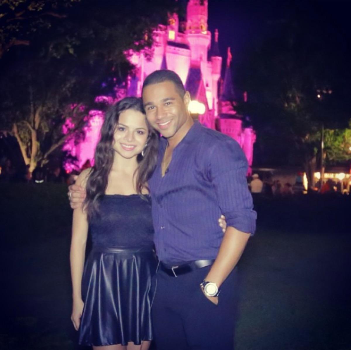 corbin bleu with girlfriend in front of castle at disney world, disney celebs