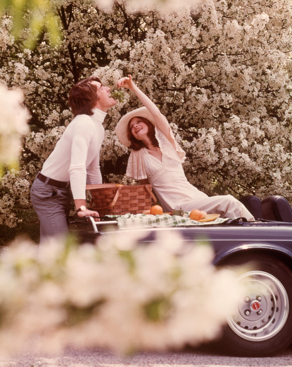 A 1970s Couple Having a Picnic on Their Car How People Used to Flirt