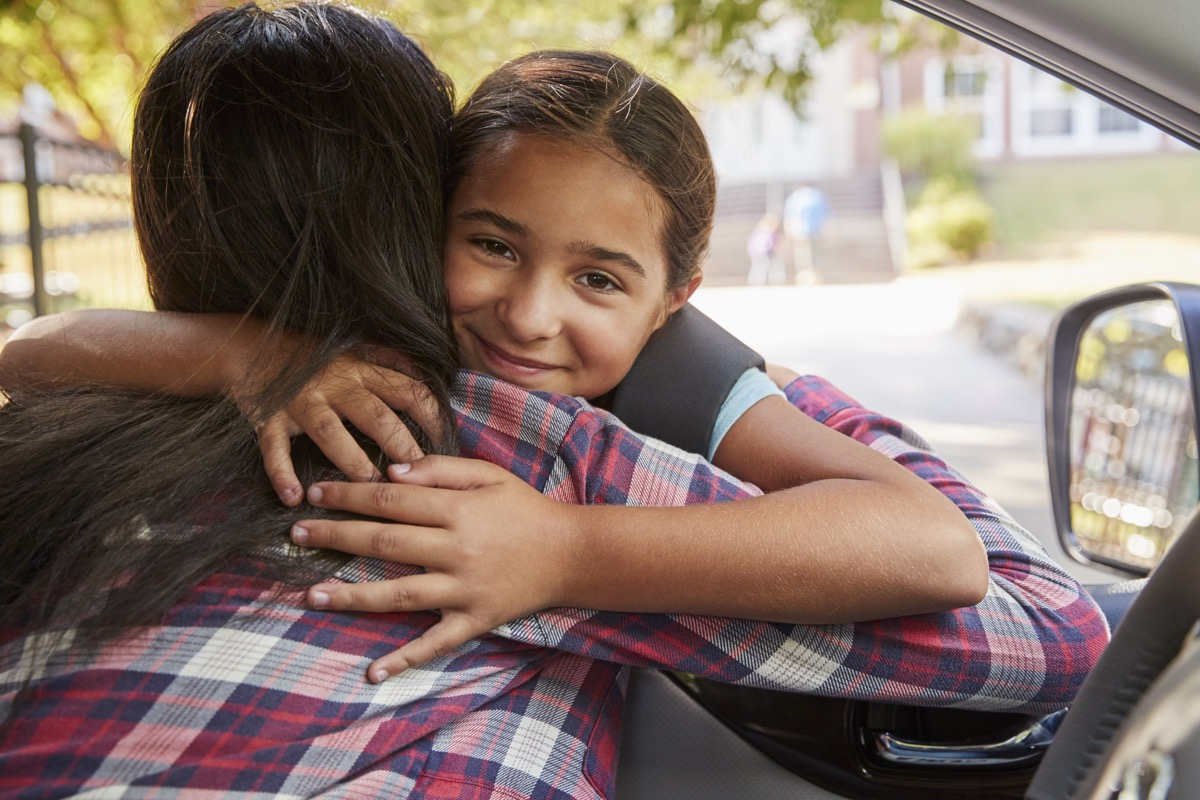 daughter hugging her mom after getting dropped off