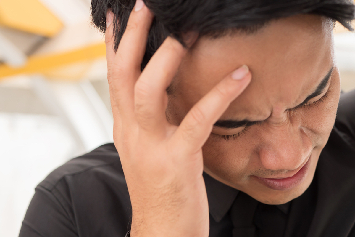 sick dizzy asian business man with headache or vertigo