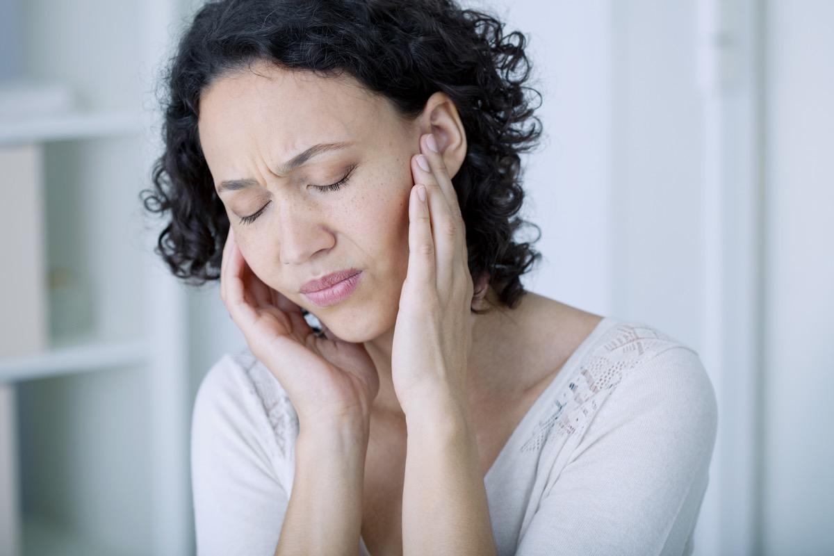 Woman experiencing ear pain