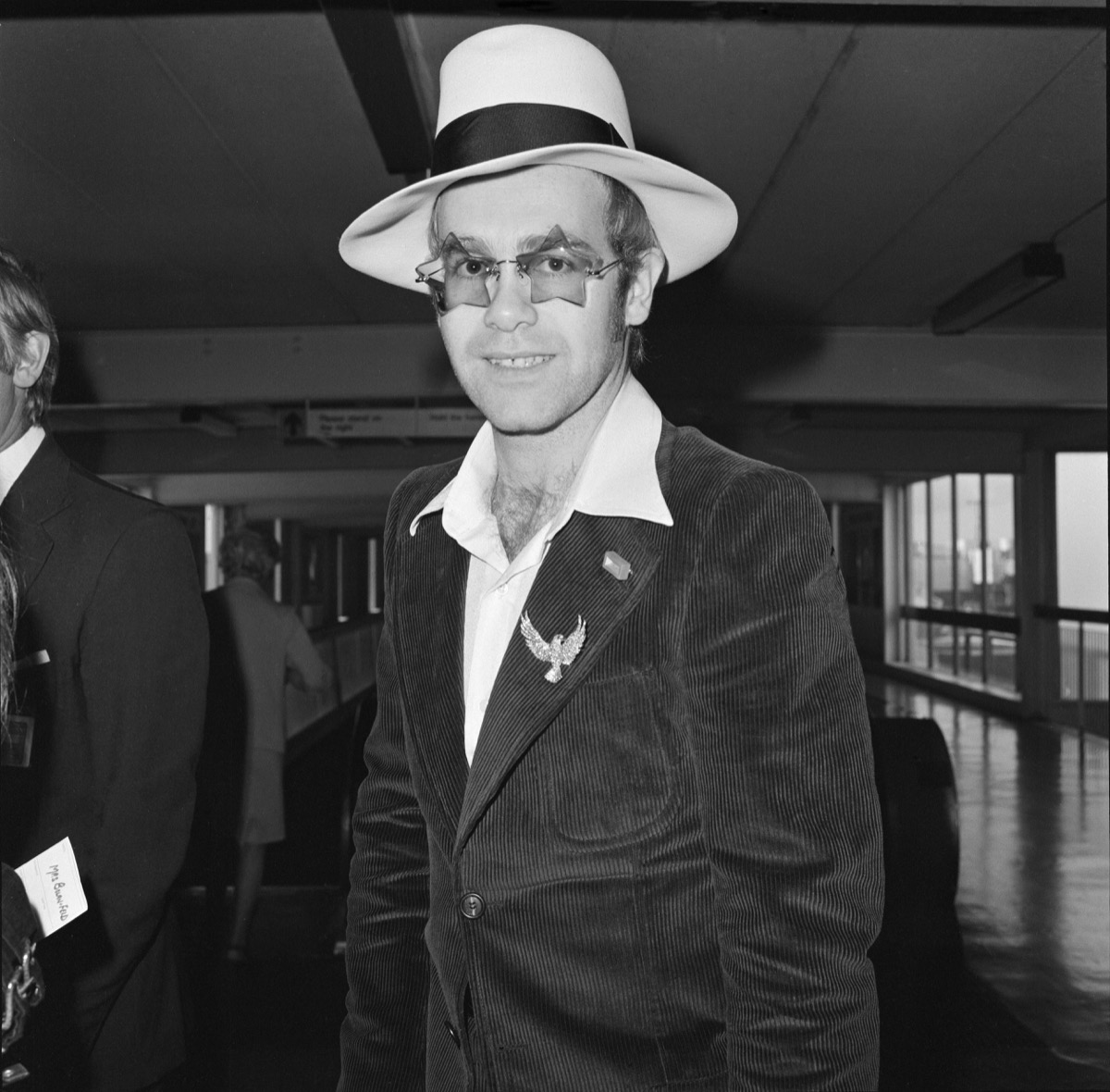 Elton John leaves Heathrow Airport. He is going to Los Angeles for the party of Elton John's Manager. Picture taken 9th September 1974
