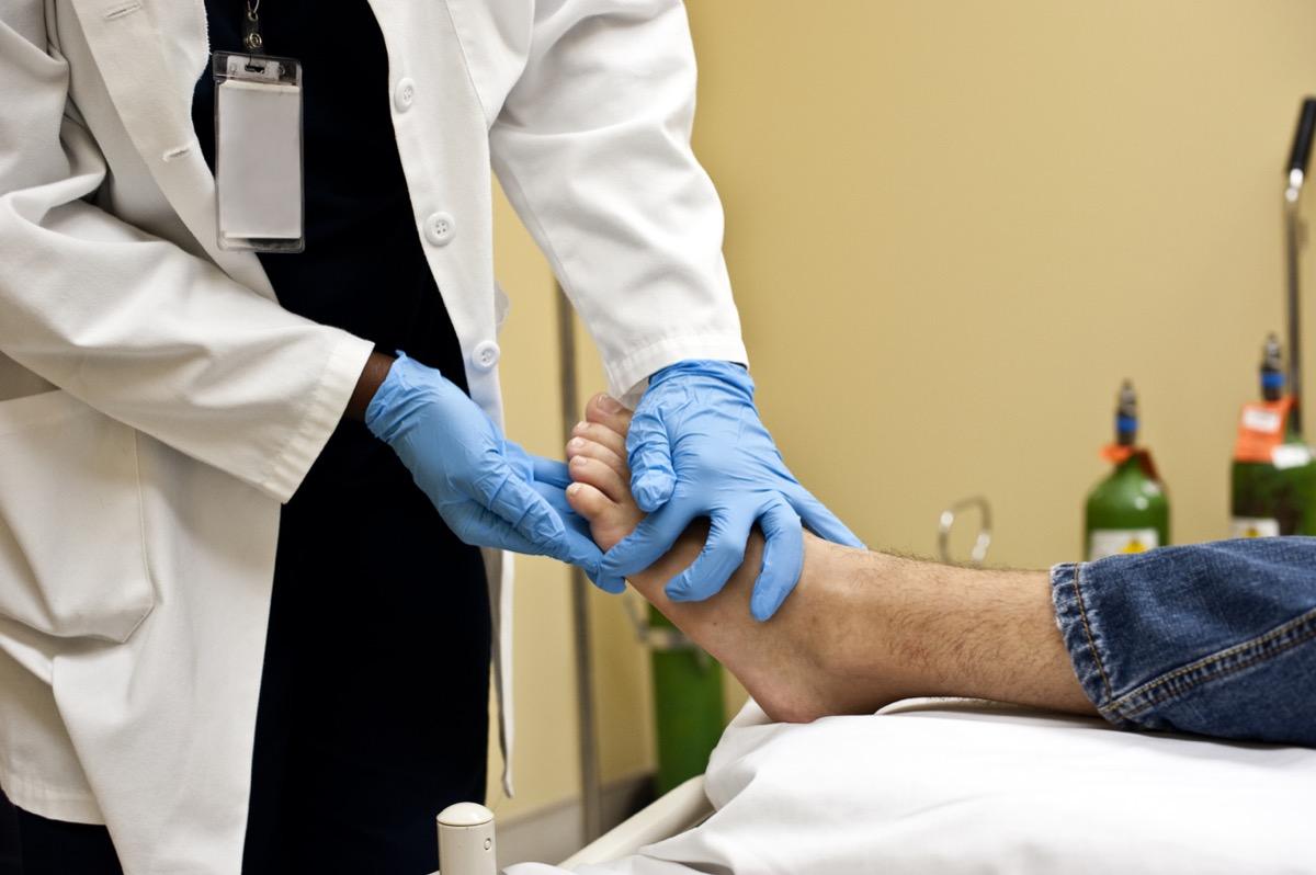 doctor examining patient's toes