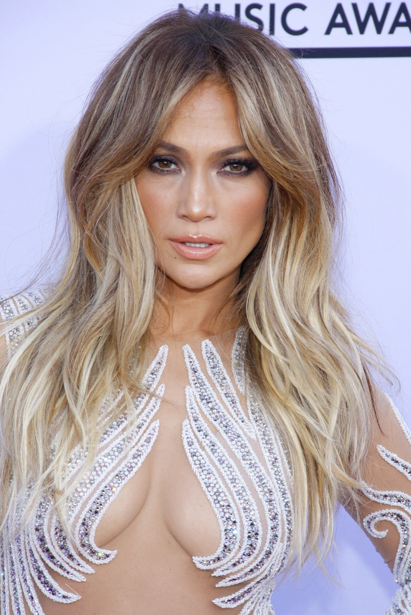 Jennifer Lopez center-parted bangs women's hairstyles