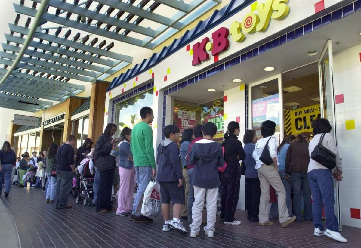 long line of people outside a K.B. Toys store
