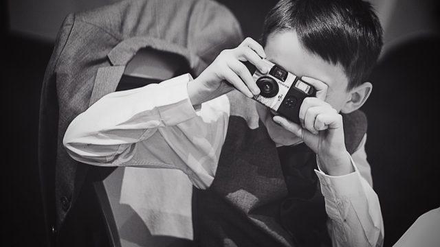 boy using a disposable camera