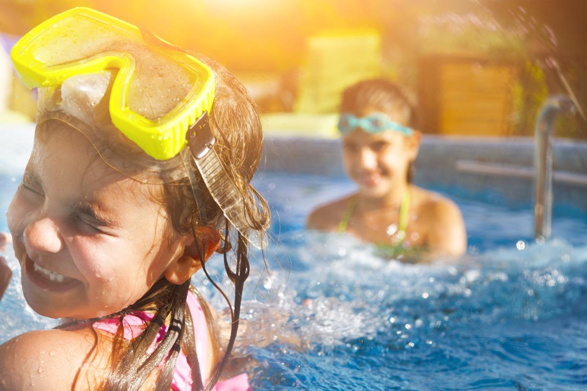 two little girls having fun in the pool, math jokes