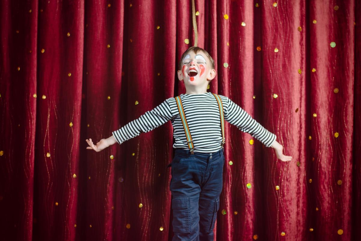 little boy dressed as clown