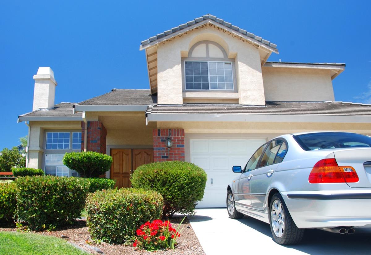 luxury car outside house