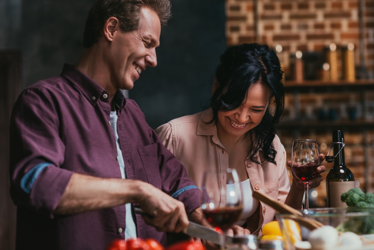 man and woman cooking in a brick-walled kitchen, better wife over 40