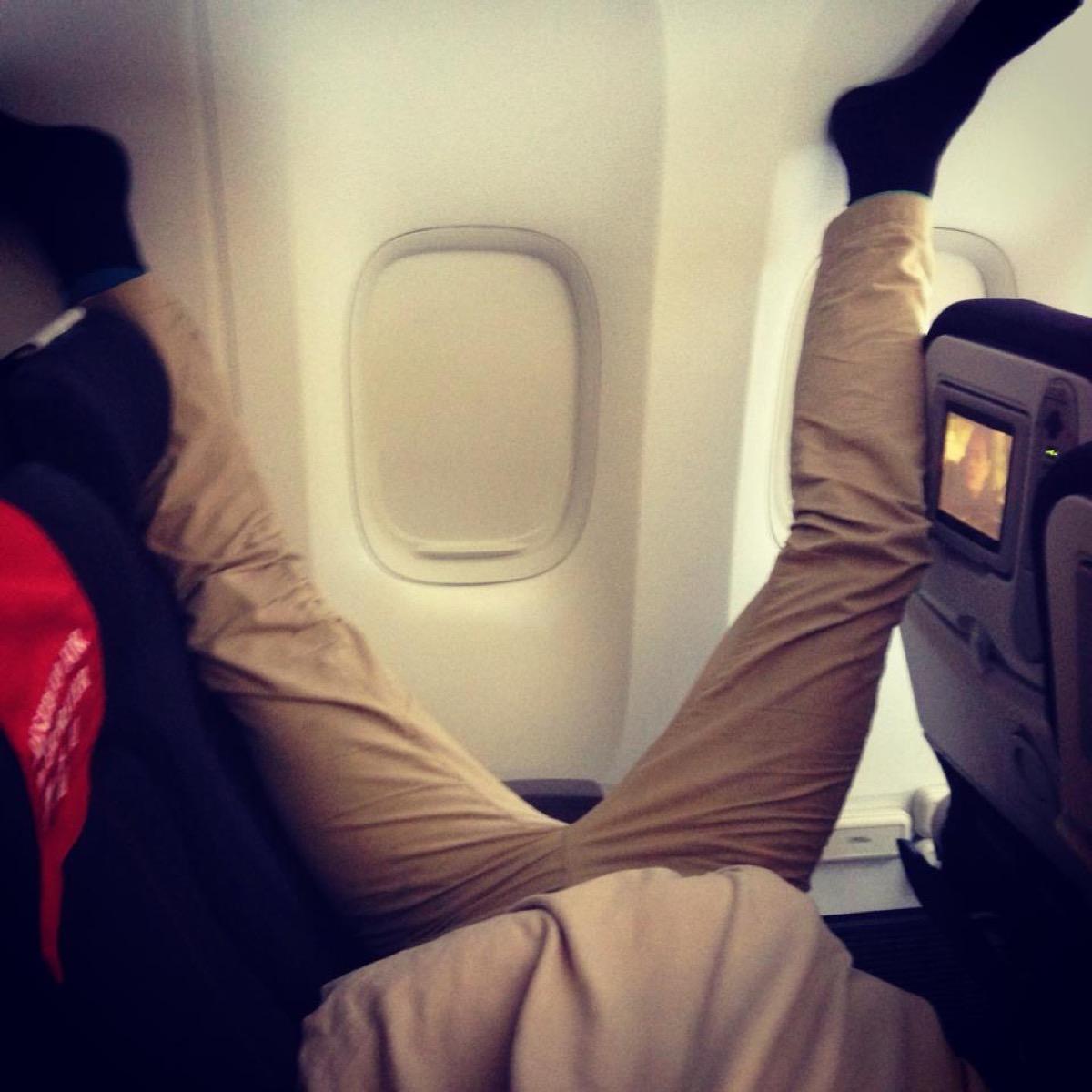 Man manspreading on plane photos of terrible airplane passengers