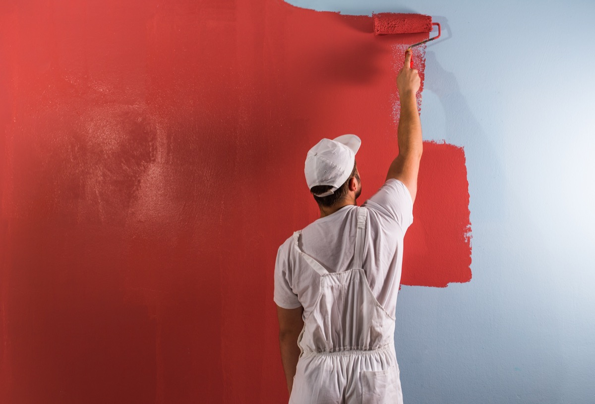 A Male Painter Painting Walls Red Worst Paint Colors
