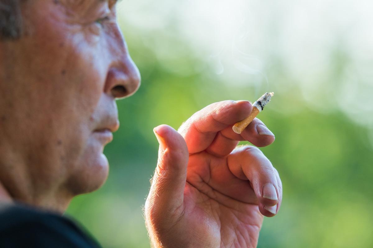 An Older Man Smoking a Cigarette