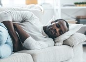 Black man experiencing stomach pain