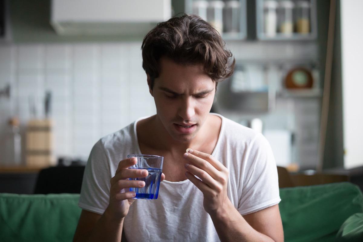 Man taking antidepressants mixing alcohol