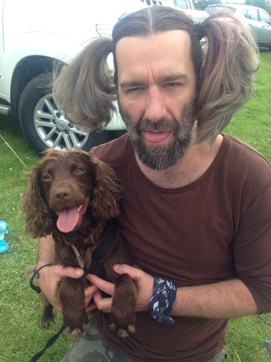 man looks just like his spaniel dogs who look like their owners