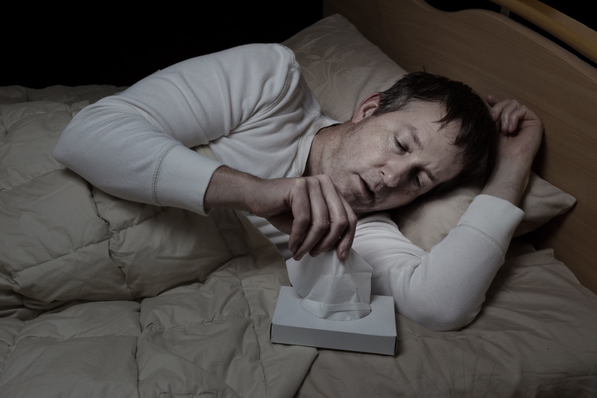 Man in Bed with Night Sweats Surprising Symptoms