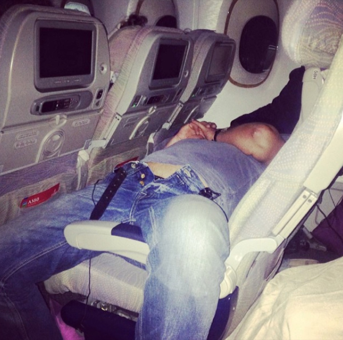 man with pants unbuttoned on airplane photos of terrible airplane passengers