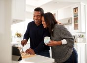 middle aged black couple cooking over stove, health changes over 40
