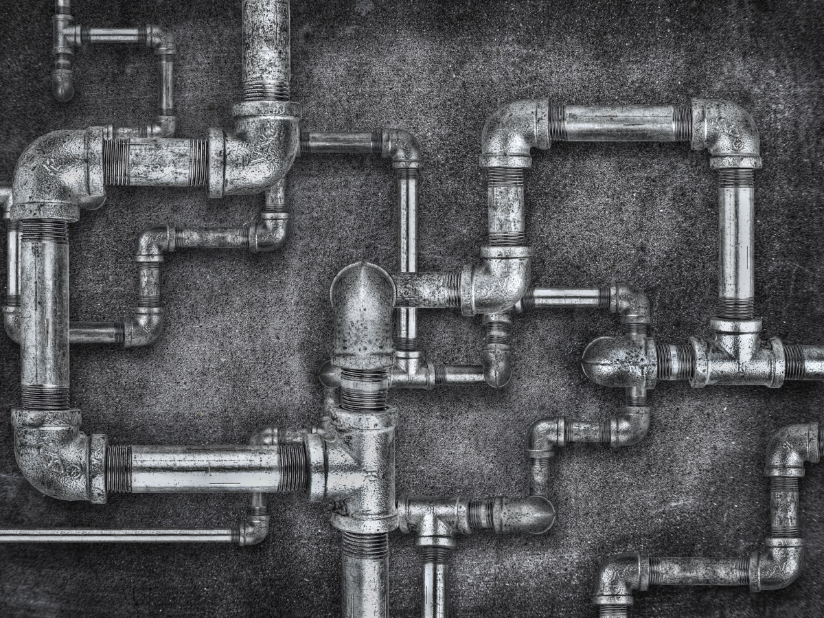 modern plumbing pipes on wall, ancient rome facts